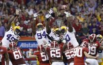 Alabama's Jeremy Shelley (90) has a field goal blocked during the first half of the BCS National Championship college football game against LSU Monday, Jan. 9, 2012, in New Orleans. (AP Photo/Gerald Herbert)