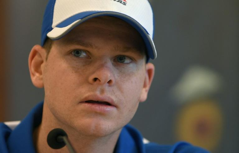 Australia's Test cricket captain Steven Smith look on during a press conference in Mumbai on February 14, 2017