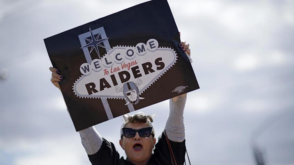 A fan displays a sign welcoming the Oakland Raiders, who plan to relocate to Las Vegas (AAP)