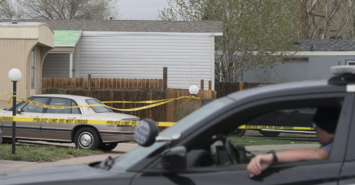 A Colorado Springs Police Department officer is stationed at the end of the street where multiple people were shot and killed early Sunday, May 9, 2021, in Colorado Springs, Colo. The suspected shooter was the boyfriend of a female victim at the party attended by friends, family and children. He walked inside and opened fire before shooting himself, police said. Children at the attack weren't hurt and were placed with relatives. (Jerilee Bennett/The Gazette via AP)