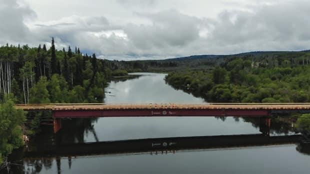 Coastal GasLink says the this temporary bridge across the Stuart River was built before salmon spawning season and will be removed after construction to minimize disturbances on the river.