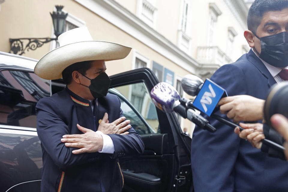 President-elect Pedro Castillo gestures as he arrives to the Foreign Ministry before going to Congress for his swearing-in ceremony on his Inauguration Day in Lima, Peru, Wednesday, July 28, 2021. (AP Photo/Guadalupe Pardo)
