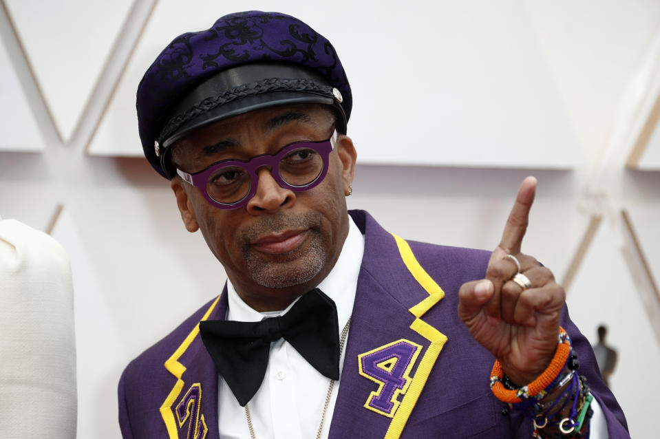 Director Spike Lee, wearing a coat with the number 24 in memory of NBA player Kobe Bryant, poses on the red carpet during the Oscars arrivals at the 92nd Academy Awards in Hollywood, Los Angeles, California, U.S., February 9, 2020. REUTERS/Eric Gaillard