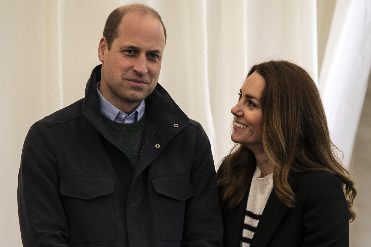 Britain's Catherine, Duchess of Cambridge and Britain's Prince William, Duke of Cambridge meet students as they visit the University of St Andrews in St Andrews on May 26, 2021. (Photo by Andy Buchanan / POOL / AFP) (Photo by ANDY BUCHANAN/POOL/AFP via Getty Images)