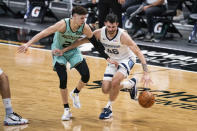 Charlotte Hornets guard LaMelo Ball (2) defends against Memphis Grizzlies guard John Konchar (46) during the first half of an NBA basketball game in Charlotte, N.C., Friday, Jan. 1, 2021. (AP Photo/Jacob Kupferman)