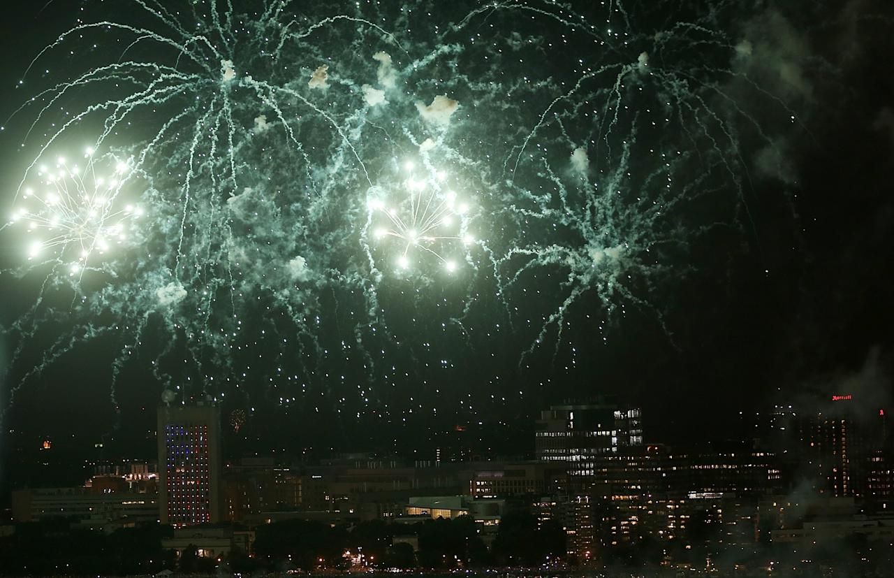 BOSTON, MA - JULY 04: Fireworks explode over the Charles River with the city of Cambridge in the background during Boston July 4th celebrations on July 4, 2013 in Boston, Massachusetts. Security has been tightened around Boston's celebrations this year in the wake of the Boston Marathon bombings which occurred on Patriots' Day in April. (Photo by Mario Tama/Getty Images)