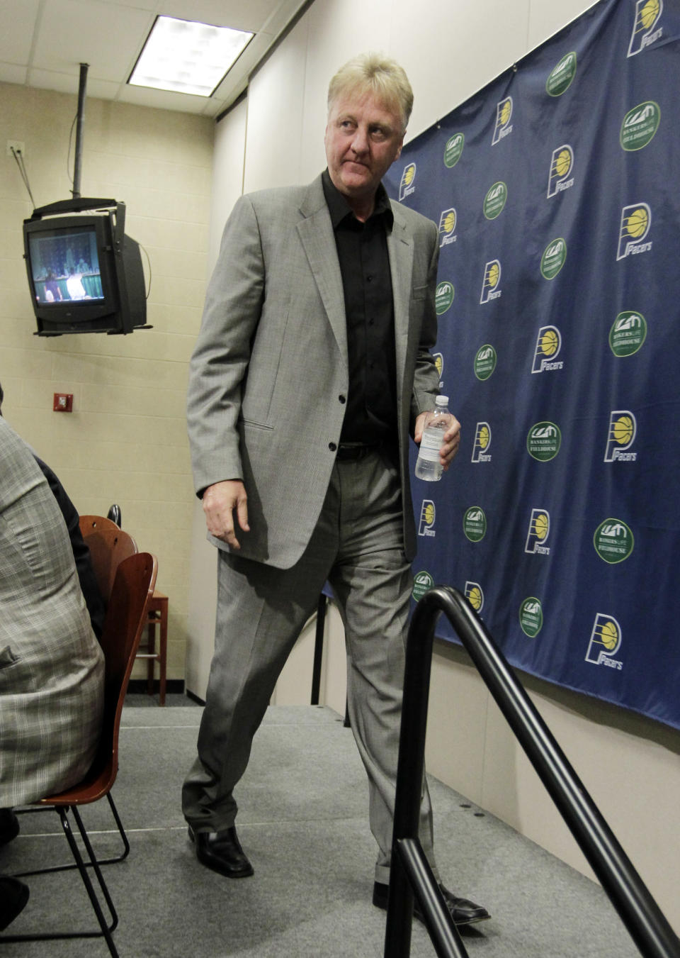 Larry Bird leaves the stage after announcing that he is stepping down as president of the Indiana Pacers at a news conference by the NBA basketball team in Indianapolis, Wednesday, June 27, 2012. Donnie Walsh was named as president and Kevin Pritchard as general manager. (AP Photo/Michael Conroy)