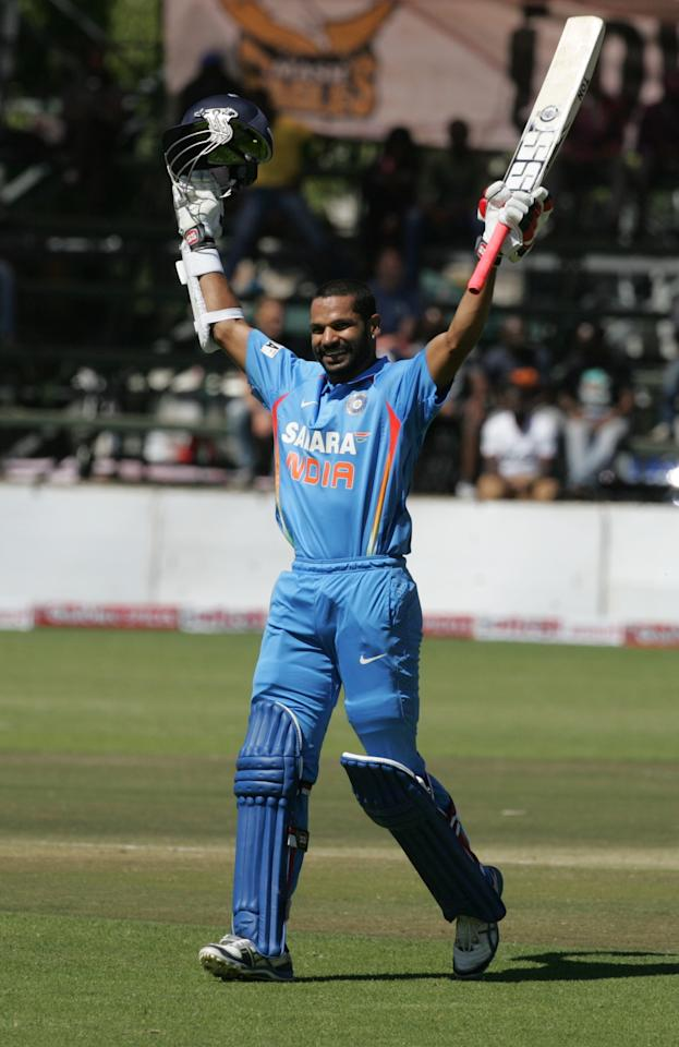 India batsman Shikhar Dhawan celebrates his century during the 2nd match of the 5 match cricket ODI series between hosts Zimbabwe and India at Harare Sports Club on July 26, 2013. AFP PHOTO /Jekesai Njikizana.        (Photo credit should read JEKESAI NJIKIZANA/AFP/Getty Images)