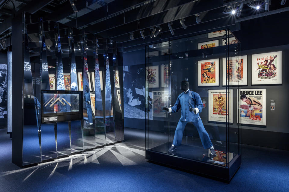 <p>A space all about Bruce Lee includes movie posters and costumes.</p>