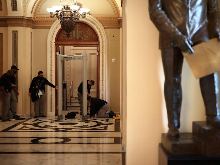 <p>US Capitol Police install a metal detector at the doors of the House of Representatives Chamber on 12 January 2021 in Washington, DC.</p> ((Getty Images))