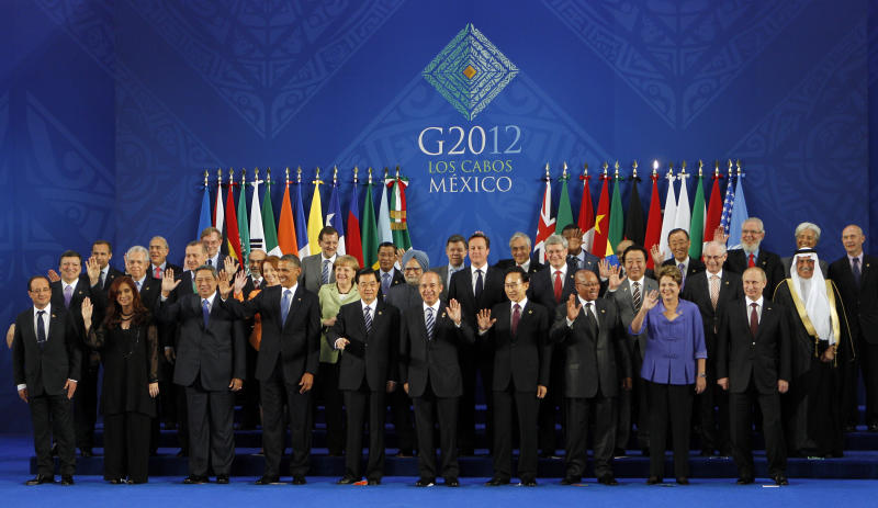 Leaders of the G-20 and guests pose for the family photo in Los Cabos, Mexico, Monday, June 18, 2012. Front row from left, France's President Francois Hollande, Argentina's President Cristina Fernandez, Indonesia's President Susilo Bambang Yudhoyono, U.S. President Barack Obama, China's President Hu Jintao, Mexico's President Felipe Calderon, South Korea's President Lee Myung-bak, South Africa's President Jacob Zuma, Brazil's President Dilma Rousseff, Russia's President Vladimir Putin. Middle row from left, European Commission's President Jose Manuel Barroso, Italy's Prime Minister Mario Monti, Turkey's Prime Minister Recep Tayyip Erdogan, Australia's Prime Minister Julia Gillard, Germany's Chancellor Angela Merkel, India's Prime Minister Manmohan Singh, British Prime Minister David Cameron, Canada's Prime Minister Stephen Harper, Japan's Prime Minister Yoshihiko Noda, European Council President Herman Van Rompuy, Saudi Arabia Minister of Finance Ibrahim bin Abdulaziz Al-Assaf. Back row from left, Chairman of the Financial Stability Board Mark Carney, OECD Secretary General Jose Angel Gurria, World Bank's President Robert Zoellick, FAO Director-General Jose Graziano da Silva, Spain's Prime Minister Mariano Rajoy, Cambodia's Prime Minister Hun Sen, Colombia's President Juan Manuel Santos, Chile's President Sebastian Pinera, Benin's President Boni Yayi, Ethiopia's Prime Minister Meles Zenawi, United Nations Secretary-General Ban Ki-moon, Director-General of the International Labour Organization Juan Somavia, IMF's Managing Director Christine Lagarde, WTO Director General Pascal Lamy. (AP Photo/Andres Leighton)