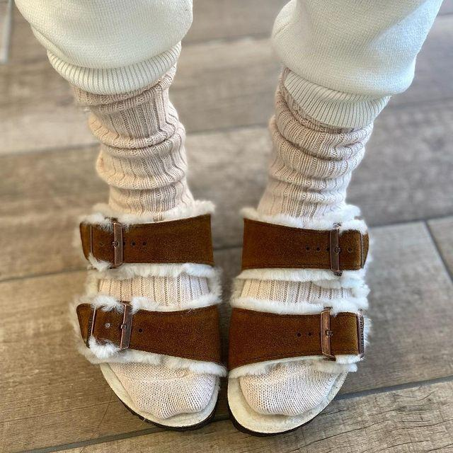 """<p>We'll consider our shearling-lined Birkenstock Arizonas as everyday wear a gateway drug to sandals-as-slippers (or slippers-as-sandals?) until further notice. Come summer, we're on board for chunkier versions that will continue to allow us to walk on air.</p><p><a href=""""https://www.instagram.com/p/CH8fBo_oral/?utm_source=ig_web_copy_link"""" rel=""""nofollow noopener"""" target=""""_blank"""" data-ylk=""""slk:See the original post on Instagram"""" class=""""link rapid-noclick-resp"""">See the original post on Instagram</a></p>"""