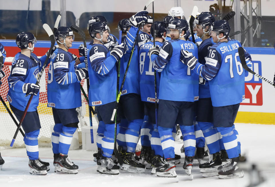 Finland's players celebrate their 1-0 victory in the Ice Hockey World Championship quarterfinal match between Finland and Czech Republic at the Arena in Riga, Latvia, Thursday, June 3, 2021. (AP Photo/Sergei Grits)