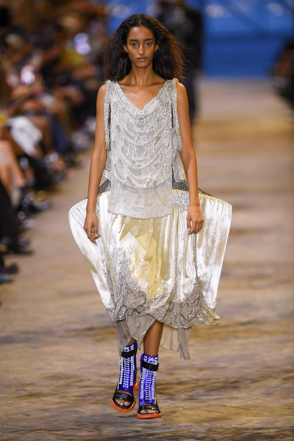 <p>Okay, let's finally address the silhouette. Now, I'm also thinking back to the structural elements at the Loewe Spring '22 show, and I must say, if the opportunity ever presented itself to wear this IRL… I kinda dig it?</p>