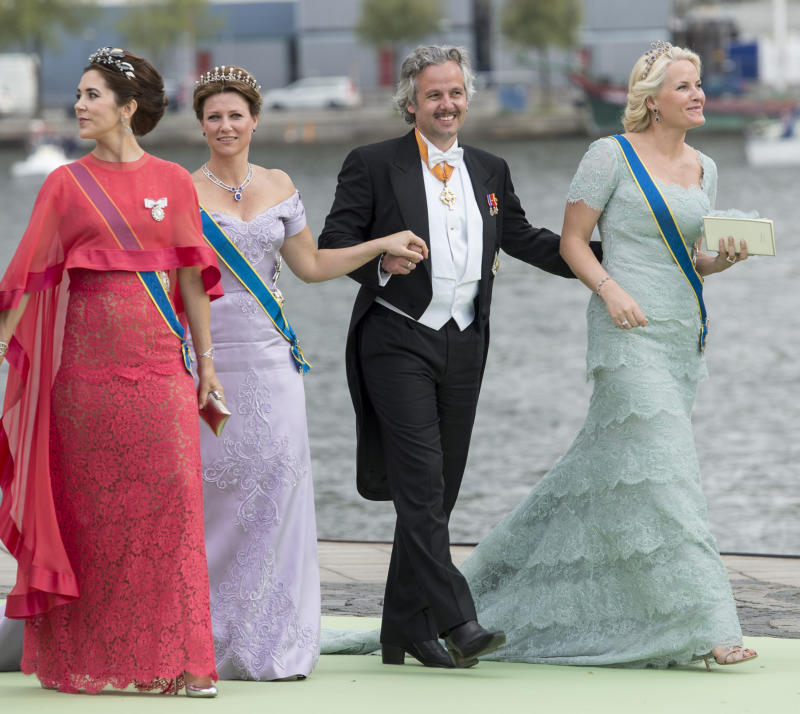 A photo of Crown Princess Mary of Denmark with Crown Princess Mette-Marit of Norway, Ari Behn and Princess Martha Louise walking to Drottningholm Palace after the wedding of Princess Madeleine of Sweden and Christopher O'Neill hosted by King Carl Gustaf and Queen Silvia at The Royal Palace on June 8, 2013 in Stockholm, Sweden.