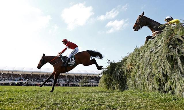 Horse Racing - Grand National Festival - Aintree Racecourse, Liverpool, Britain - April 14, 2018 Tiger Roll ridden by Davy Russell clears the last fence before winning the 17:15 Randox Health Grand National Handicap Chase REUTERS/Darren Staples