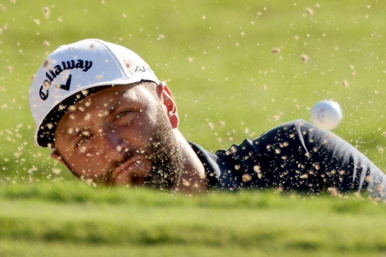 Spain's Jon Rahm of Spain plays his shot from the bunker on the way to a birdie at the 18th in the second round of the US PGA Tour Championship (AFP/Kevin C. Cox)