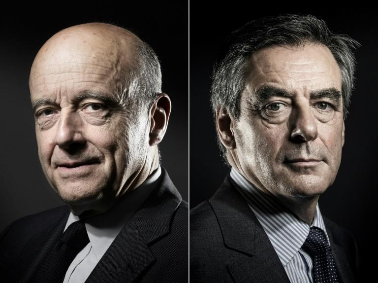 Former French prime ministers Alain Juppe (left) and Francois Fillon