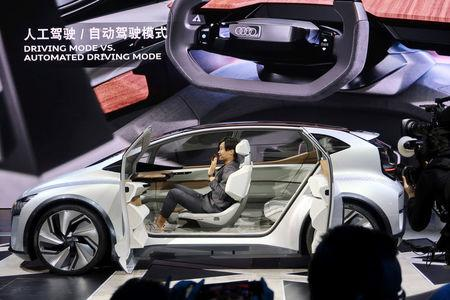 FILE PHOTO: Designer presents an Audi AI:me concept car during an unveiling event in Shanghai