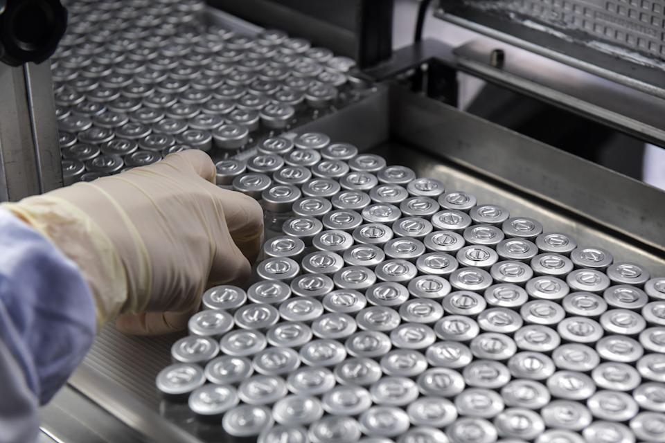 An employee works on the production line of CoronaVac, Sinovac Biotech's vaccine against COVID-19 coronavirus at the Butantan biomedical production center, in Sao Paulo, Brazil, on January 14, 2021. - Sao Paulo state is due to begin immunizing its 12 million citizens from January 25. Beijing has already sent 10.7 million Coronavac doses and the supplies needed to make another 40 million doses. The health ministry, though, has yet to divulge when it will launch a nationwide immunization program. (Photo by NELSON ALMEIDA / AFP) (Photo by NELSON ALMEIDA/AFP via Getty Images)