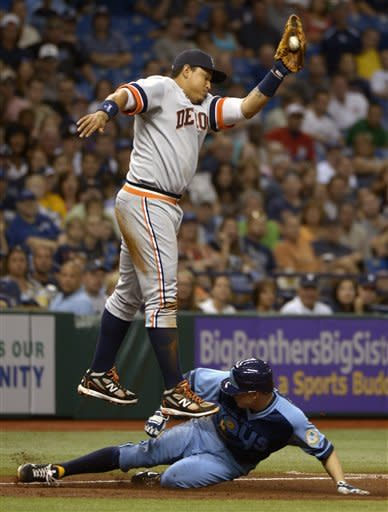 Tampa Bay Rays' Elliot Johnson, bottom, slides safely into third base below the tag of Detroit Tigers third baseman Miguel Cabrera on a ground-out by Will Rhymes during the third inning of a baseball game in St. Petersburg, Fla., Saturday, June 30, 2012. (AP Photo/Phelan M. Ebenhack)
