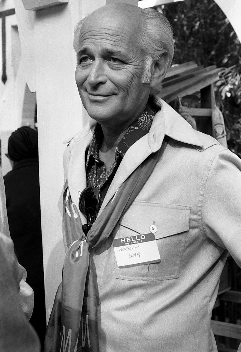 """<p><a href=""""http://www.normanlear.com/backstory/"""" rel=""""nofollow noopener"""" target=""""_blank"""" data-ylk=""""slk:According to his official bio"""" class=""""link rapid-noclick-resp"""">According to his official bio</a>, Lear began his television writing career in 1950 with business partner Ed Simmons. The two wrote for Jack Haley's <em>The Ford Star Revue, </em>then moved on to Jerry Lewis and Dean Martin's <em>Colgate Comedy Hour. </em>From there they went to <em>The Martha Raye Show, </em>before Lear went solo for <em>The Tennessee Ernie Ford Show</em> and <em>The George Gobel Show.</em></p>"""