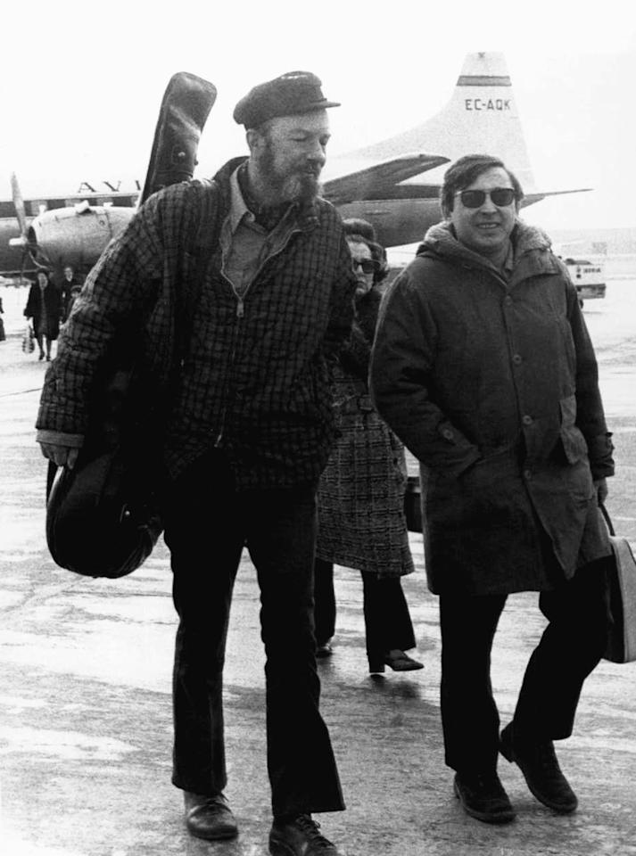 File-This Feb. 10, 1971, file photo shows American Folk singer Pete Seeger, left, with Spanish singer Raymond, at Madrid's Barajas airport enroute to a concert in the southern Spanish city of Seville. The American troubadour, folk singer and activist Seeger died Monday Jan. 27, 2014, at age 94. (AP Photo/L. Gomez, File)