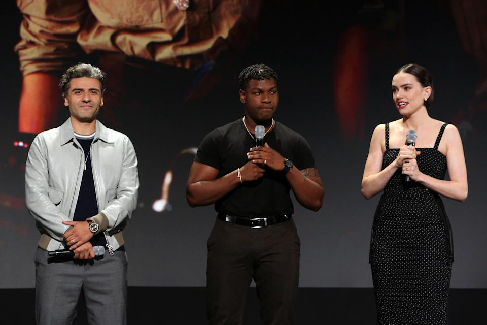 ANAHEIM, CALIFORNIA - AUGUST 24: (L-R) Oscar Isaac, John Boyega, and Daisy Ridley of 'Star Wars: The Rise of Skywalker' took part today in the Walt Disney Studios presentation at Disney's D23 EXPO 2019 in Anaheim, Calif.  'Star Wars: The Rise of Skywalker' will be released in U.S. theaters on December 20, 2019. (Photo by Jesse Grant/Getty Images for Disney)