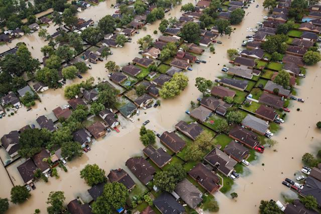 <p>Residential neighborhoods near the Interstate 10 sit in floodwater in the wake of Hurricane Harvey on August 29, 2017 in Houston, Texas. (Photo: Marcus Yam / Los Angeles Times via Getty Images) </p>