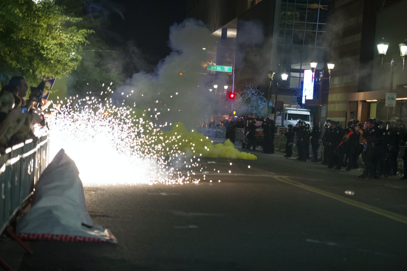 There were clashes outside the rally between protesters and police, who fired tear gas (Picture: Rex)