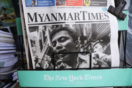 A Myanmar newspaper displays the story about the sentences received by Reuters journalists Wa Lone and Kyaw Soe Oo, on its front page in Yangon, Myanmar, September 4, 2018. REUTERS/Ann Wang