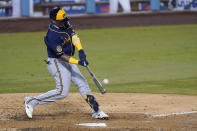 Milwaukee Brewers' Orlando Arcia connects for a two-run home run during the fourth inning in Game 1 of the team's National League wild-card baseball series against the Los Angeles Dodgers on Wednesday, Sept. 30, 2020, in Los Angeles. (AP Photo/Ashley Landis)