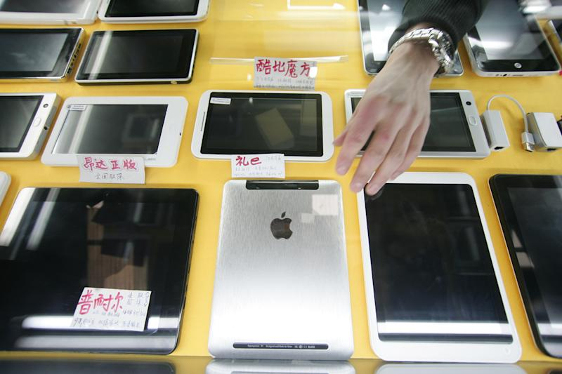 """In this March 4, 2012 photo, some iPad-like devices are displayed at a shop in Shanghai, China. Apple's troubles in China over the iPad trademark are not its first, and given its penchant for """"iproducts"""" they are unlikely to be its last. China's importance as a major consumer market is bringing fresh headaches for companies, and even celebrities, seeking to protect and claim brand names. That's on top of the usual problems with piracy and other infringements. (AP Photo)"""