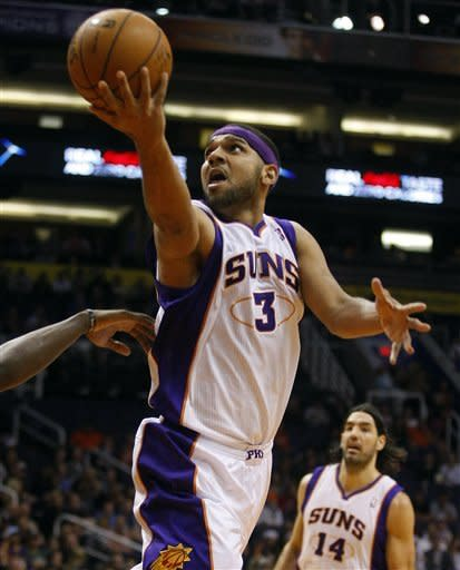 Phoenix Suns guard Jared Dudley (3) scores against the Utah Jazz in the third quarter during an NBA basketball game on Friday, Dec. 14, 2012, in Phoenix. The Suns defeated the Jazz 99-84. (Rick Scuteri/AP Photos)
