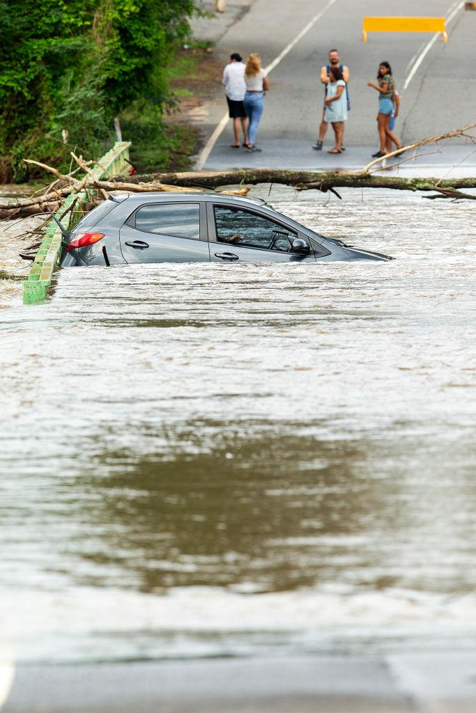 A submerged car is seen on a bridge over the Nepean River at Cobbitty on February 10, 2020 in Sydney, Australia.