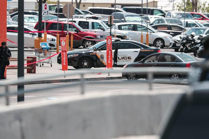 Various police and law enforcement personnel surround a Walmart in El Paso after a gunman entered the store near Cielo Vista Mall and opened fire on Saturday, Aug. 3, 2019, killing 22 people.