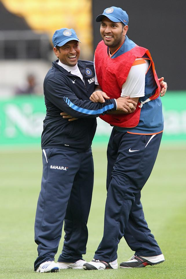 WELLINGTON, NEW ZEALAND - FEBRUARY 27:  Sachin Tendulkar and Yuvraj Singh of India warm up before the second Twenty20 international match between the New Zealand Blacks Caps and India at Westpac Stadium on February 27, 2009 in Wellington, New Zealand.  (Photo by Marty Melville/Getty Images)