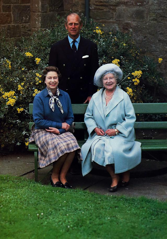 A photograph from a Christmas card dated 1985 showing Queen Elizabeth II and the Duke of Edinburgh alongside the Queen Mother in her 85th year. [PA]