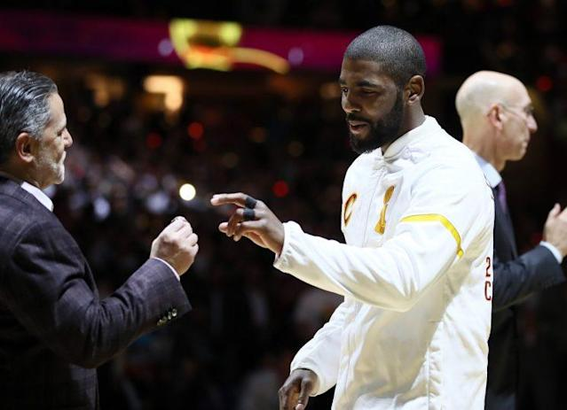 "<a class=""link rapid-noclick-resp"" href=""/nba/players/4840/"" data-ylk=""slk:Kyrie Irving"">Kyrie Irving</a> received his championship ring from Dan Gilbert. (Getty)"