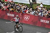 Ecuador's Richard Carapaz celebrates victory in the men's cycling road race -- only the second gold in the South American country's history