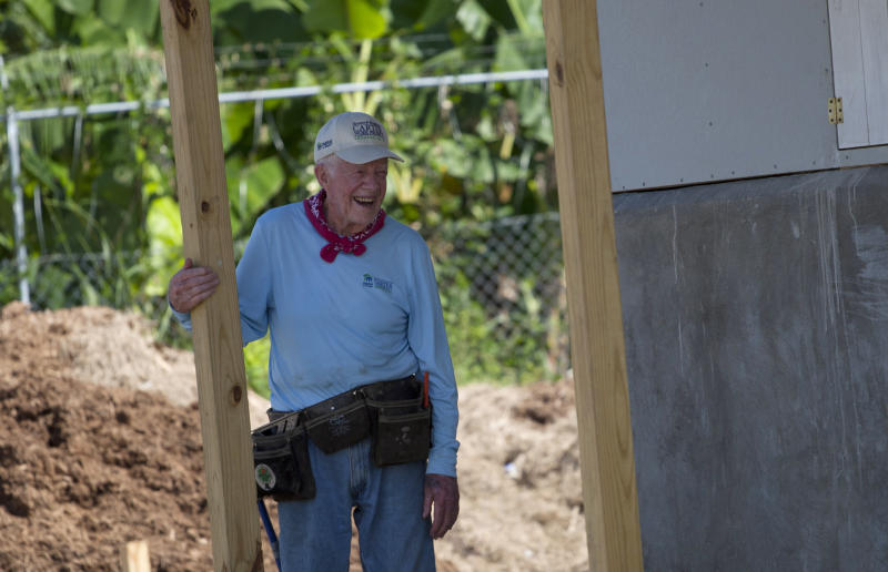 Former President Jimmy Carter visits a Habitat for Humanity project in Leogane, Haiti, Monday, Nov. 26, 2012. The former president and former first lady were both taking an active part Monday in the construction of 100 one-room houses on about 14 acres. Families will get to live in the homes rent-free for five years and then will have to pay a modest annual rent to the government. (AP Photo/Dieu Nalio Chery)