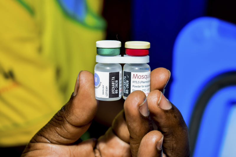 A health worker displays the new malaria vaccine in Homabay County, western Kenya, Friday, Sept. 13, 2019  The vaccine is the world's first for malaria and has been rolled out in Kenya, Ghana, and Malawi by the World Health Organisation (AP Photo/Joseph Oduor)