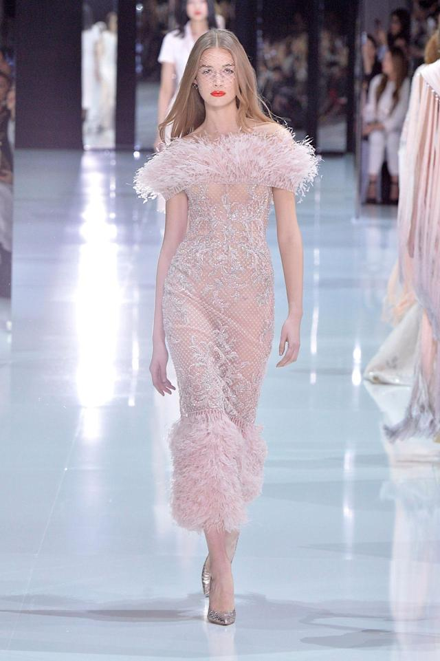 <p>Model wears a pink feather- and crystal-embellished gown from the Ralph & Russo SS18 Haute Couture show. (Photo: Getty Images) </p>