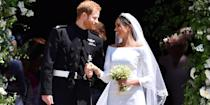 <p>Harry exits St. George's chapel with his new wife, Meghan, after their wedding. <br></p>