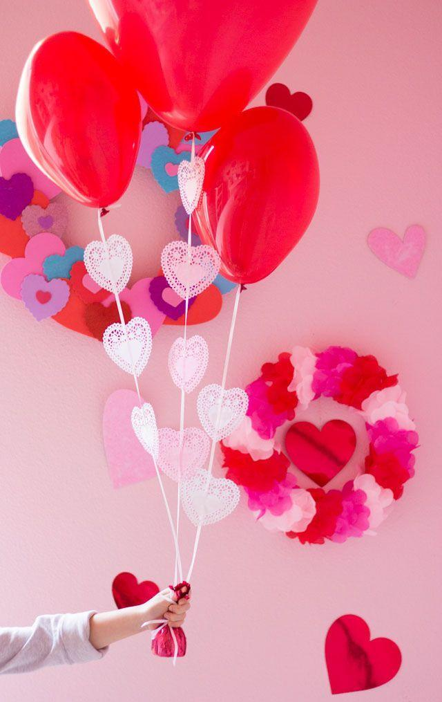 """<p>Take your pink-and-red balloon bouquet up a notch by adding a few mini heart doilies to the ribbons. This 30-second craft will make a world of difference. </p><p><em><a href=""""https://designimprovised.com/2017/02/heart-doily-valentine-balloons.html"""" rel=""""nofollow noopener"""" target=""""_blank"""" data-ylk=""""slk:Get the tutorial at Design Improvised »"""" class=""""link rapid-noclick-resp"""">Get the tutorial at Design Improvised »</a></em><br></p>"""