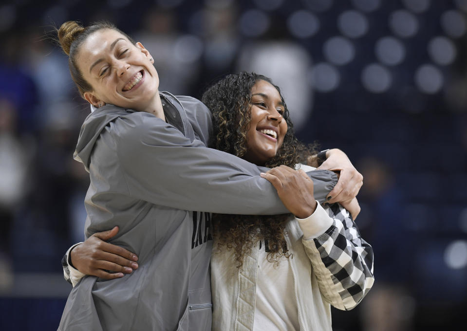 Former Connecticut players and WNBA Seattle Storm players Breanna Stewart, left, Kaleena Mosqueda-Lewis embrace after an NCAA college exhibition basketball game between Connecticut and Jefferson, Sunday, Nov. 3, 2019, in Storrs, Conn. (AP Photo/Jessica Hill)