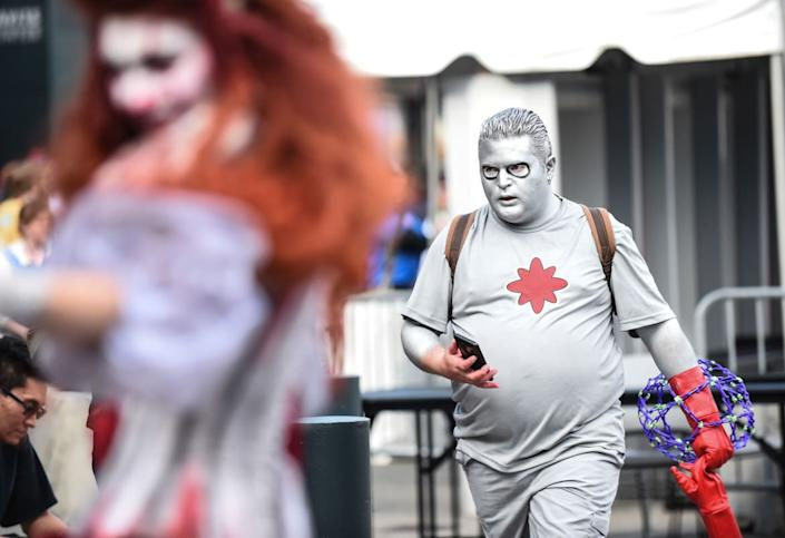 """<div class=""""inline-image__caption""""><p>A general view of atmosphere during New York Comic Con 2019 on October 04, 2019 in New York City. </p></div> <div class=""""inline-image__credit"""">DANIEL ZUCHNIK/Getty</div>"""