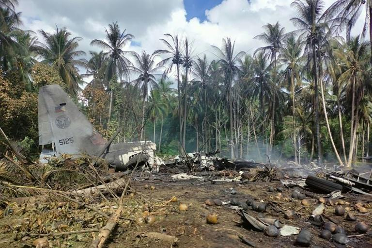 Philippine security forces searched for flight data boxes from a military aircraft crash that killed 52 people
