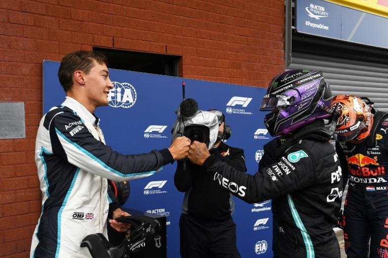 George Russell (L) celebrates after taking second place in the grid with third-placed Lewis Hamilton (R) at August's Belgian Grand Prix (AFP/JOHN THYS)