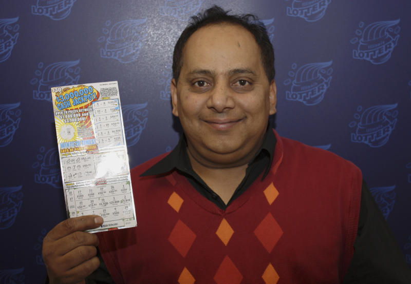 FILE - This undated file photo provided by the Illinois Lottery shows Urooj Khan, 46, of Chicago's West Rogers Park neighborhood, posing with a winning instant lottery ticket. On Friday, March 1, 2013, the Cook County medical examiner is expected to release results of an autopsy on the exhumed remains of Khan who was poisoned with cyanide after winning the lottery. (AP Photo/Illinois Lottery, File)